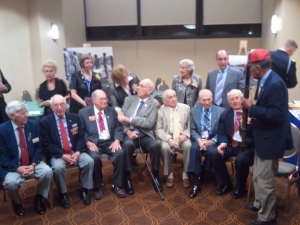 8 WWII veterans, seated